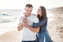 Beautiful young couple on the sandy beach of the sea Royalty Free Stock Photos