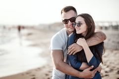 Beautiful young couple on the sandy beach of the sea Stock Image