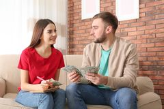 Beautiful young couple with money stock photos