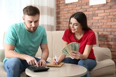 Beautiful young couple with money stock image