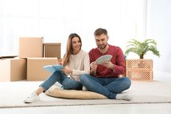 Beautiful young couple with money stock images