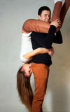 Beautiful young couple on the move. A young men holding his girlfriend on hands Stock Images
