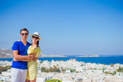 Beautiful young couple at Mykonos island, Cyclades. Tourists enjoy their greek vacation in Greece background famous. Young couple at Mykonos island, Cyclades Stock Image