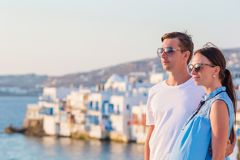 Beautiful young couple at Mykonos island, Cyclades. Tourists enjoy their greek vacation in Greece background famous Stock Photo