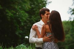 Beautiful young couple on a nature background Stock Images