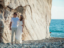 Beautiful young couple near the rock Royalty Free Stock Images