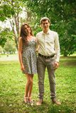 Beautiful young couple in the park stock photos