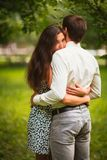 Beautiful young couple in the park royalty free stock photography