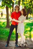 Beautiful young couple on the park background Royalty Free Stock Photos