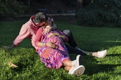 Beautiful young couple in the park. stock photography