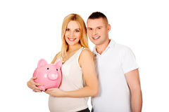 Beautiful young couple with piggy bank Royalty Free Stock Images