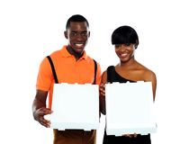 Beautiful young couple with pizza boxes Stock Image