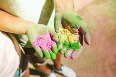 Beautiful young couple playing in the park on holi colours festival. Royalty Free Stock Photos
