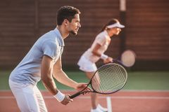 Couple playing tennis Royalty Free Stock Photos