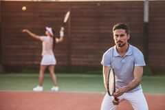 Couple playing tennis Royalty Free Stock Photo