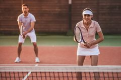 Couple playing tennis Stock Photography