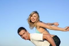 Beautiful young couple playing together Stock Photos