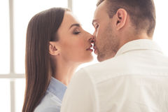Beautiful young couple. Portrait of beautiful young loving couple kissing tenderly with closed eyes Royalty Free Stock Photo