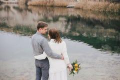 Beautiful young couple posing near lake Stock Photography