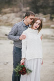 Beautiful young couple posing near lake Royalty Free Stock Photography