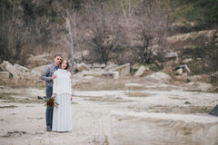 Beautiful young couple posing near lake Stock Images