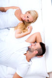 Beautiful young couple relaxing in Bed Royalty Free Stock Photos