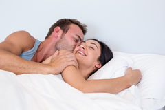 Beautiful young couple relaxing. In their bedroom Royalty Free Stock Photography