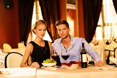Beautiful young couple in restaurant Royalty Free Stock Image