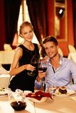 Beautiful young couple in restaurant Royalty Free Stock Photos