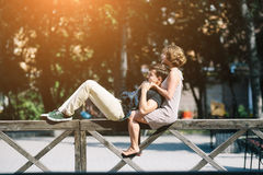 Beautiful young couple resting on a fence Royalty Free Stock Photo