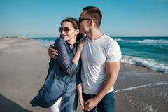 Beautiful young couple on the sandy beach of the sea Royalty Free Stock Photography