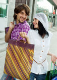 Beautiful young couple after shopping. Outdoor shot Stock Photo