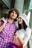 Beautiful young couple after shopping. Outdoor shot Stock Photography