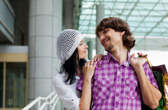 Beautiful young couple after shopping. Outdoor shot Stock Images