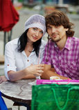 Beautiful young couple after shopping. Outdoor shot Royalty Free Stock Photos
