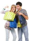 Beautiful young couple with shopping bags Stock Photos