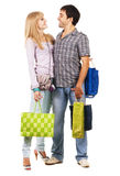 Beautiful young couple with shopping bags Stock Images