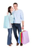 Beautiful young couple with shopping bags Royalty Free Stock Photos