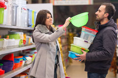 Beautiful Young Couple Shopping In A Grocery Supermarket Stock Photos