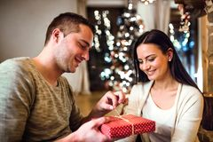 Young couple at Christmas time. Royalty Free Stock Photo