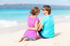 Beautiful young couple sitting and having fun on Royalty Free Stock Photo
