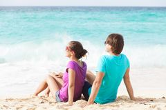 Beautiful young couple sitting and having fun on Stock Image