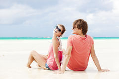 Beautiful young couple sitting and having fun on Royalty Free Stock Images