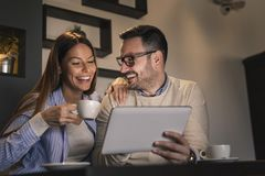 Couple having a video call on a tablet computer stock photos