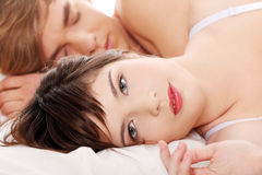 Beautiful young couple sleeping. Beautiful young couple sleeping in bed Royalty Free Stock Photos
