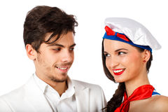 Beautiful young couple smiling. Passionate sexy young couple roleplay sailor and captain looking at each other. Isolated on white background. High resolution Royalty Free Stock Photography