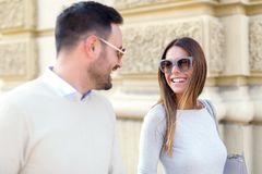 Beautiful young couple smiling while walking outdoors. On sunny day Stock Images