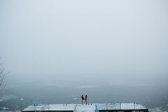 Beautiful young couple standing on a pier Stock Image