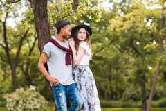 Beautiful young couple standing together in park Stock Images