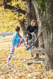 Beautiful young couple stretching together and cool down after training in the park Royalty Free Stock Images